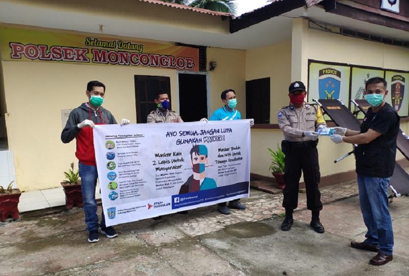 Ikatan Fisioterapi Indonesia (IFI) cabang Makassar bekerjasama Polsekta Moncongloe berbagi masker gratis